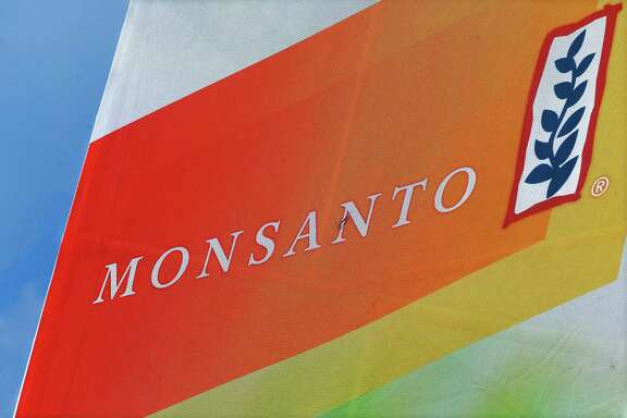 "FILE - This Aug. 31, 2015, file photo, shows the Monsanto logo seen at the Farm Progress Show in Decatur, Ill. Monsanto is rejecting Bayer's $62 billion takeover bid, calling it ""incomplete and financially inadequate. However, the seed company suggested Tuesday, May 24, 2016, that a higher bid might be accepted, saying that it remains open to talks. (AP Photo/Seth Perlman, File)"