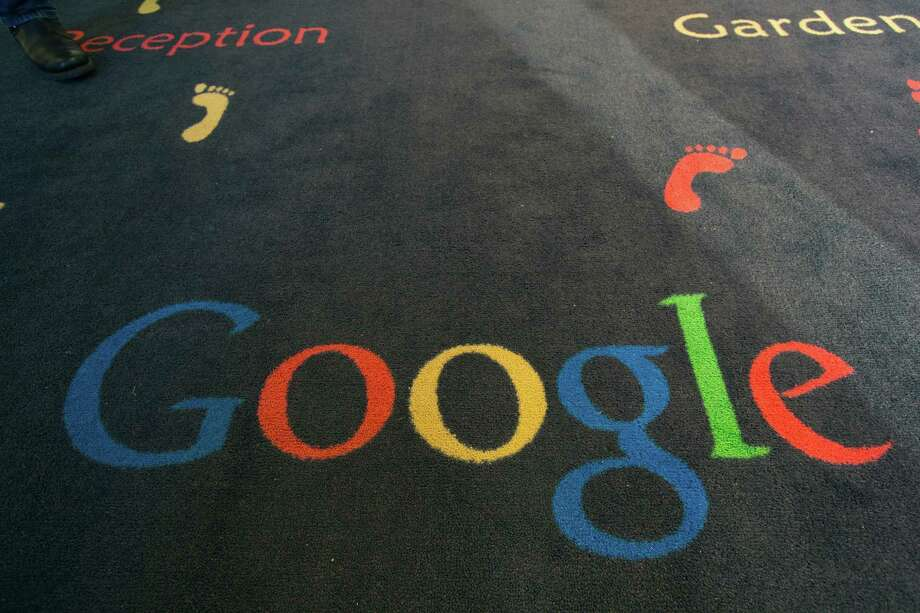 "FILE -  This Tuesday, Dec. 10, 2013 file photo shows the Google logo printed on a carpet during the inauguration of the new Google cultural institute in Paris, France. French police have raided Google's Paris offices as part of an investigation into ""aggravated tax fraud"" and money laundering, authorities said Tuesday. (AP Photo/Jacques Brinon, File) Photo: Jacques Brinon, STF / AP"