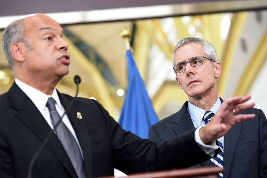 Transportation Security Administration (TSA) Administrator Peter Neffenger listens at right as Homeland Security Secretary Jeh Johnson speaks at news conference on airport security, Friday, may 13, 2016, at Washington's Ronald Reagan National Airport. Fliers across the country have been facing growing lines, which during peak hours have topped 90 minutes at some airports. The TSA has fewer screeners and has tightened security procedures. Meanwhile, more people are flying.  (AP Photo/Sait Serkan Gurbuz) Photo: Sait Serkan Gurbuz, FRE / FR171401 AP