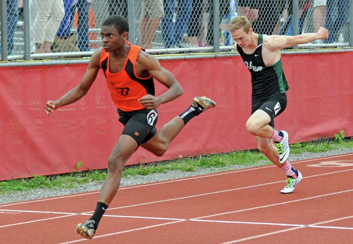 Bethlehem's Malick Diomande wins the boy's 100 during the Section II Group 1 track and field championships on Tuesday May 24, 2016 in Guilderland, N.Y. (Michael P. Farrell/Times Union)
