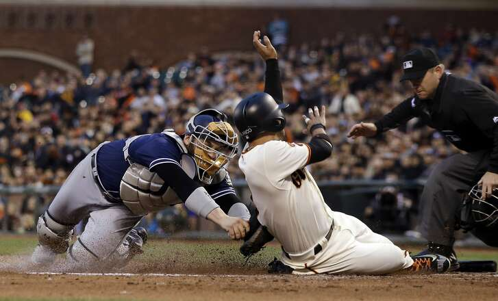 San Francisco Giants' Gregor Blanco, right, scores past the tag attempt from San Diego Padres catcher Derek Norris on a single by Denard Span during the third inning of a baseball game Tuesday, May 24, 2016, in San Francisco. (AP Photo/Marcio Jose Sanchez)
