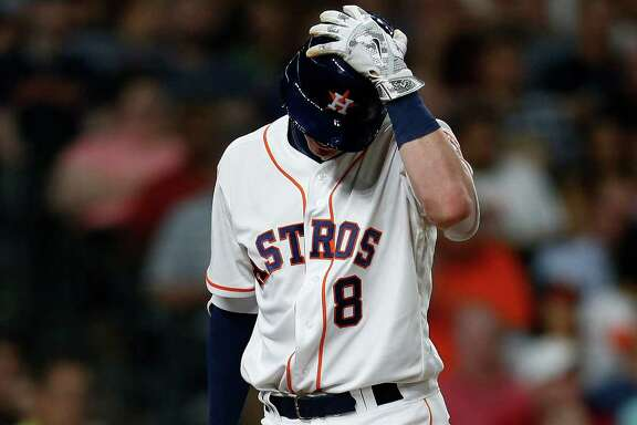 Houston Astros third baseman Colin Moran (8) reacts after striking out during the seventh inning of an MLB baseball game at Minute Maid Park, Tuesday, May 24, 2016.