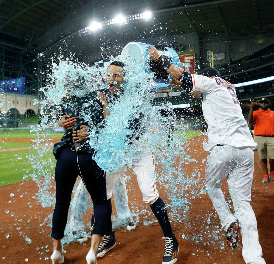 Houston Astros shortstop Carlos Correa (1) gets doused by Powerade after his RBI single wins the game during the thirteenth inning of an MLB baseball game at Minute Maid Park, Tuesday, May 24, 2016. Photo: Karen Warren, Houston Chronicle / © 2016 Houston Chronicle
