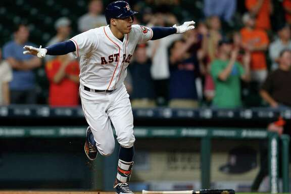 Houston Astros shortstop Carlos Correa (1) reacts after his RBI single wins the game during the thirteenth inning of an MLB baseball game at Minute Maid Park, Tuesday, May 24, 2016.