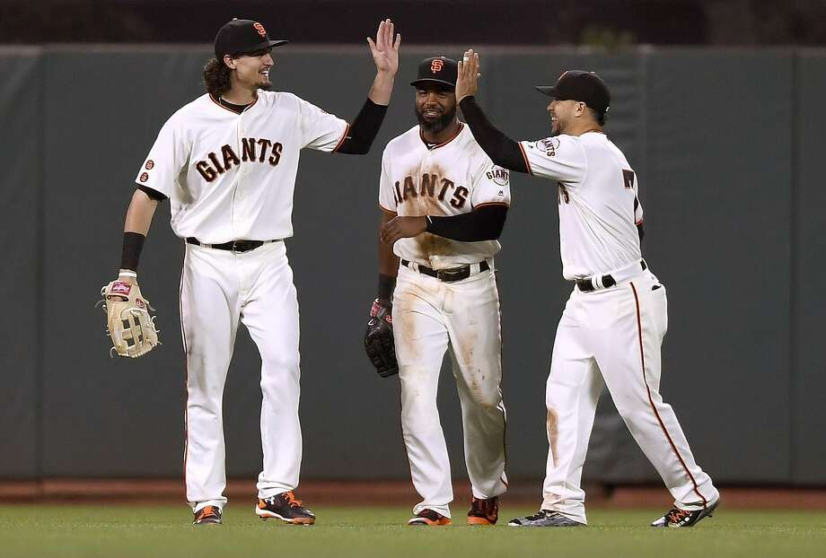 "Outfielders Jarrett Parker, Denard Span and Gregor Blanco celebrate Tuesday night's win. Span is off Wednesday, but Parker returns under Bruce Bochy's ""Hit a Home Run, Play the Next Day"" rule. Photo: Thearon W. Henderson, Getty Images"