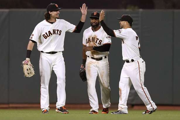 SAN FRANCISCO, CA - MAY 24:  (L-R) Jarrett Parker #6, Denard Span #2 and Gregor Blanco #7 of the San Francisco Giants celebrate defeating the San Diego Padres 8-2 at AT&T Park on May 24, 2016 in San Francisco, California.  (Photo by Thearon W. Henderson/Getty Images)