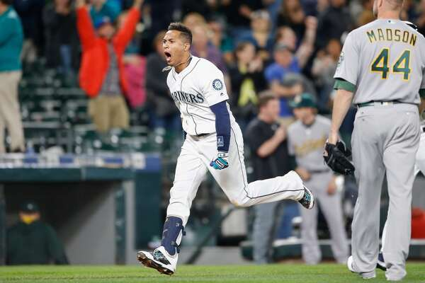 SEATTLE, WA - MAY 24: Leonys Martin #12 of the Seattle Mariners heads home after hitting a two-run walk-off homer to defeat the Oakland Athletics 6-5 at Safeco Field on May 24, 2016 in Seattle, Washington. (Photo by Otto Greule Jr/Getty Images)