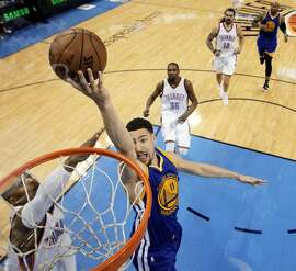 Klay Thompson (11) puts in a layup in the first half as the Golden State Warriors played the Oklahoma City Thunder in Game 4 of the Western Conference Finals at Chesapeake Energy Arena in Oklahoma City, Okla., on Tuesday, May 24, 2016. The Thunder defeated the Warriors 118-94, to take a 3 games to 1 lead.