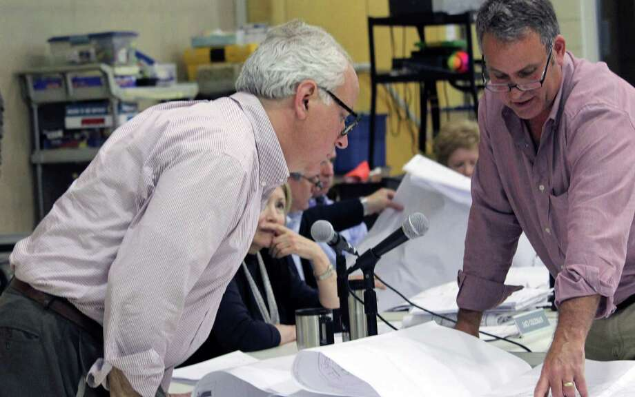 Town Plan and Zoning Commission Christopher McAleese, left, looks over site plans for an apartment building on Bronson Road with Garden Homes project engineer Steve Trinkaus. Photo: Genevieve Reilly / Hearst Connecticut Media / Fairfield Citizen