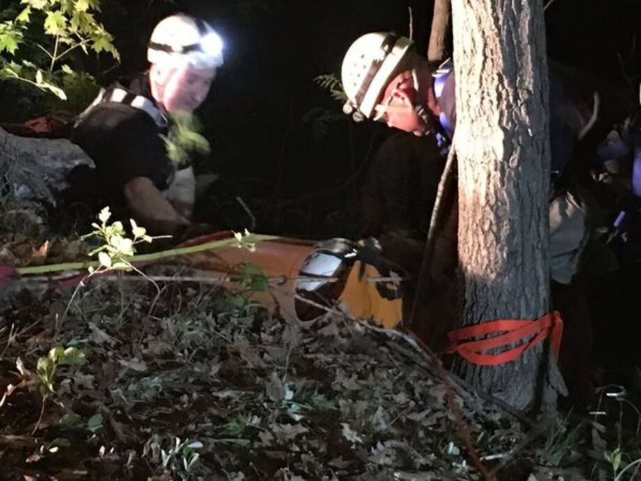 The Albany County Sheriff's Office and volunteer firefighters work to rescue a woman who fell off a 60-foot cliff in New Scotland on Tuesday night, May 24, 2016. (Photo from Albany County Sheriff Craig D. Apple)