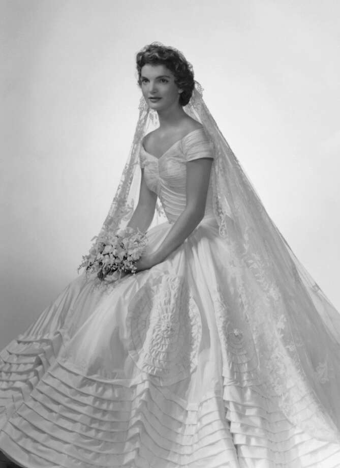 Bridal portrait of Jacqueline Lee Bouvier (1929 - 1994) shows her in an Anne Lowe-designed wedding dress, a bouquet of flowers in her hands, New York, New York, 1953. Photo: Getty Images