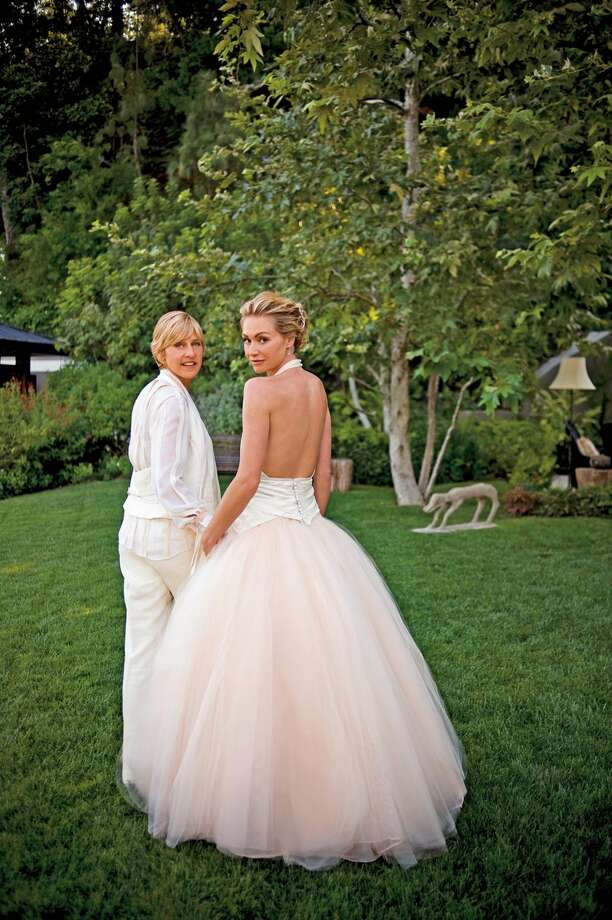 Comedian Ellen DeGeneres and actress Portia de Rossi pose for photos celebrating their marriage in the backyard of their home on August 16, 2008 in Beverly Hills, California. Photo: Getty Images