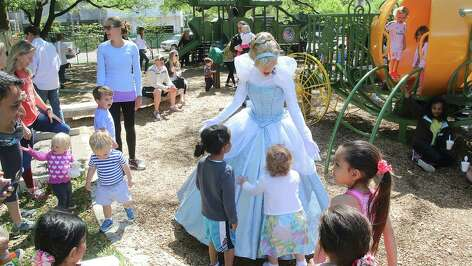 Children gather around a princess during a Family Day celebration at River Oaks Park, also known as Pumpkin Park. The event showcased the renovated playground areas and the reinstallation of a refurbished pumpkin carriage.