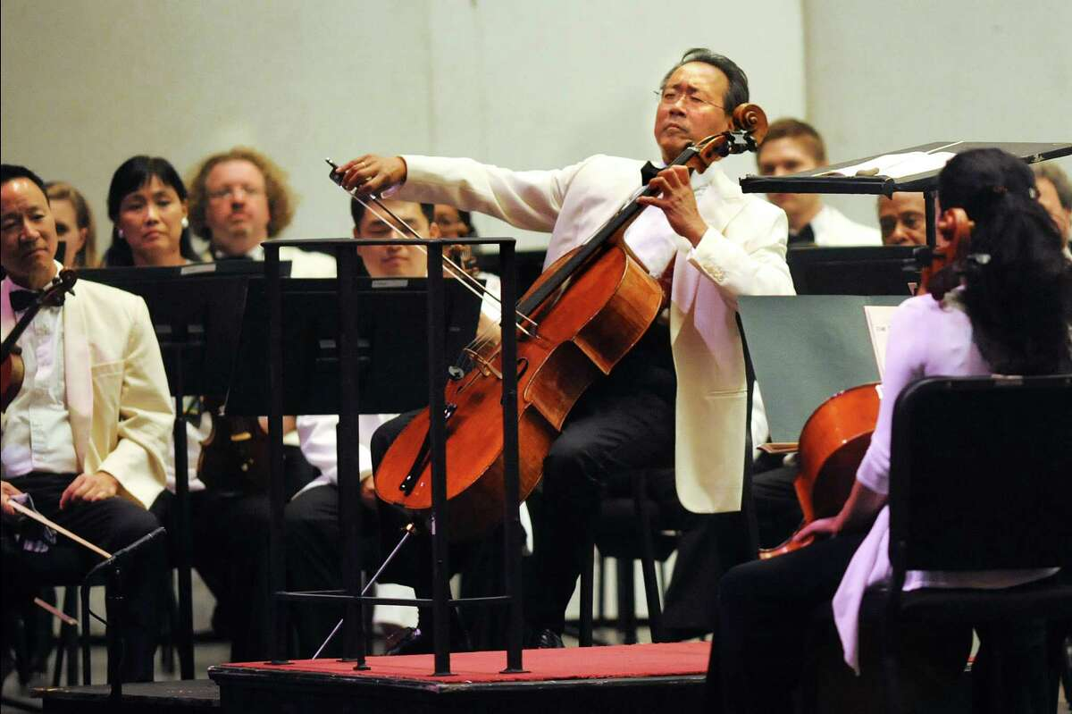 Cellist Yo-Yo Ma, center, delights the audience with an encore while performing with the Philadelphia Orchestra on Friday, Aug. 7, 2015, at Saratoga Performing Arts Center in Saratoga Springs, N.Y. (Cindy Schultz / Times Union)