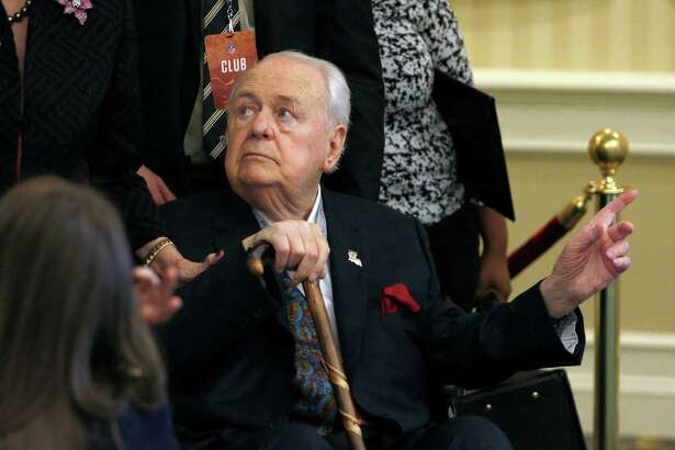 New Orleans Saints owner Tom Benson points the way into the NFL owner's meeting in Charlotte N.C., Tuesday, May 24, 2016. (AP Photo/Bob Leverone)