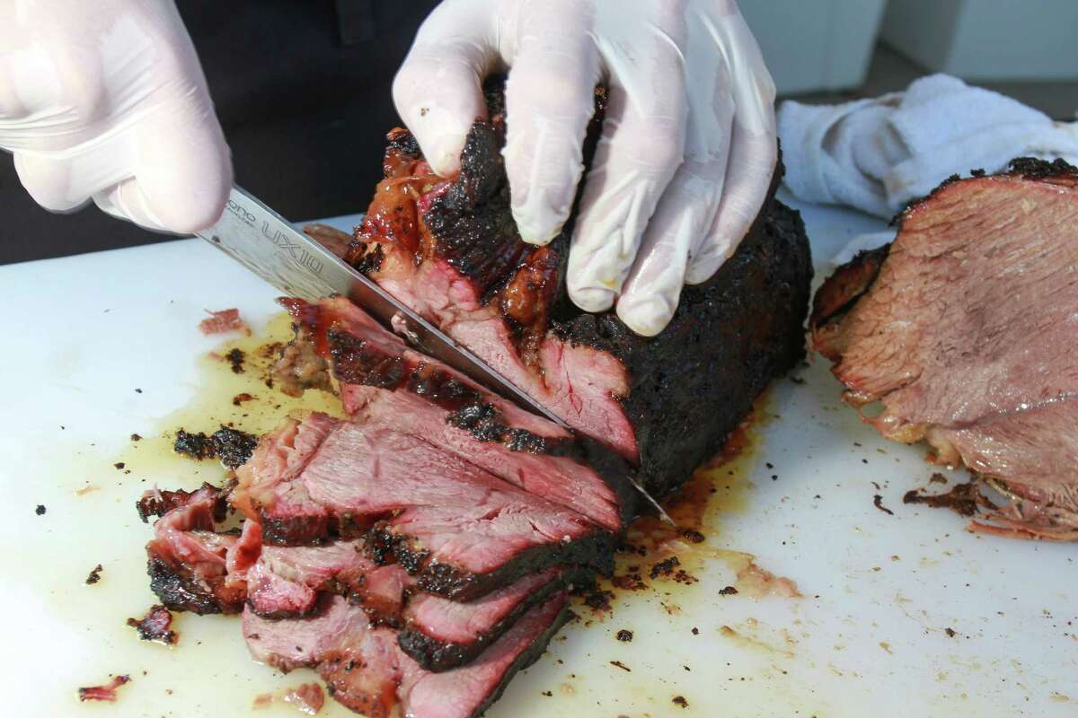 Texas barbecue and whole hog North Carolina barbecue will be offered at the HOUBBQ Collective tailgate party at Eight Row Flint on Oct. 9.