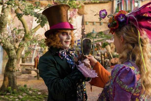 """Johnny Depp and Mia Waskikowska star in """"Alice Through the Looking Glass."""""""