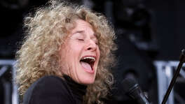 Carole King performs Oct. 21, 2001, at RFK Stadium in Washington. King will receive the Johnny Mercer Award from the Songwriters Hall of Fame at the induction and awards ceremony on June 13. (AP Photo/Pablo Martinez Monsivais, File)