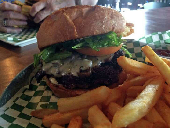 Grab a Mushroom & Provolone Burger at Little J's on Washington Avenue in celeberation of National Hamburger Day on Saturday.