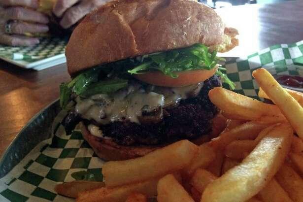 Grab a Mushroom & Provolone Burger at Little J's on Washington Avenue in celeberation of National Hamburger Day on Saturday.