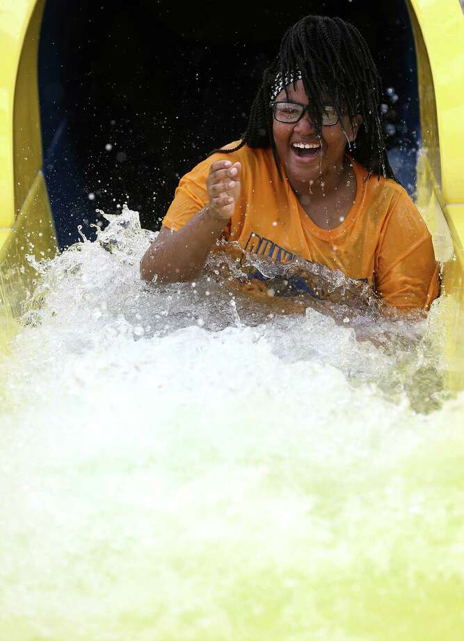 J'Maria Smith, 13, is all smiles after going down a waterslide at Typhoon Texas water park during its soft opening on May 23. It officially opens May 28. Photo: Elizabeth Conley, Staff / © 2016 Houston Chronicle
