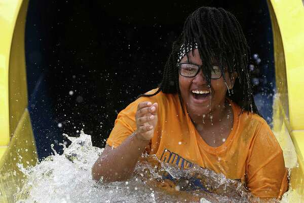 J'Maria Smith, 13, is all smiles after going down a waterslide at Typhoon Texas water park during its soft opening on Monday, May 23, 2016, in Katy. ( Elizabeth Conley / Houston Chronicle )