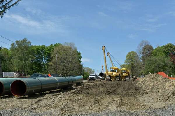 Construction on the Algonquin pipe line expansion project along Ridgewood Street at Clapboard Ridge Road, in Danbury, Conn. Tuesday, May 10, 2016.