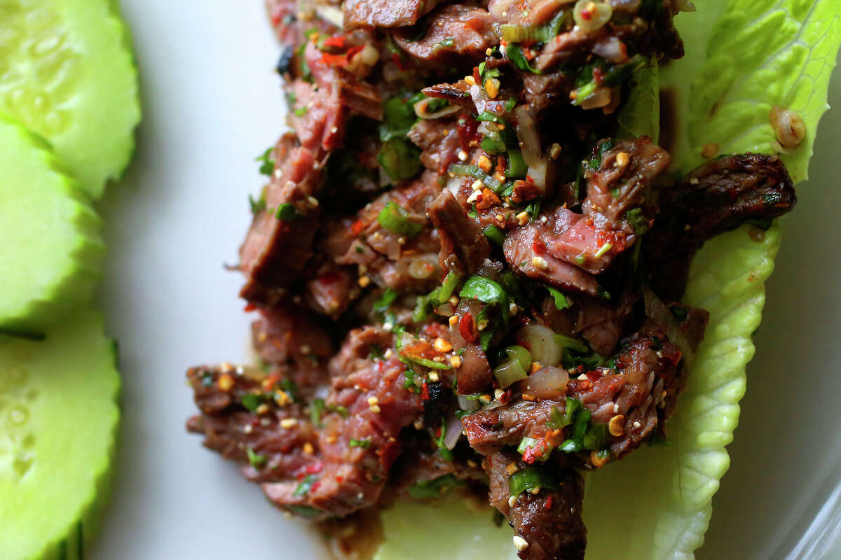Nam Took, a beef dish with toasted rice and herbs, deftly transposes textures.