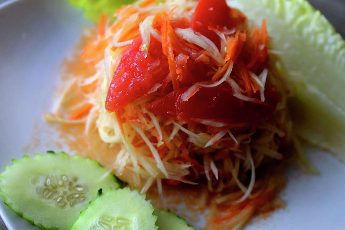Green papaya salad, or somtum, is one of the best-known dishes from Northeast Thailand. At Baan Esaan, it's also available with shredded carrots or apples.