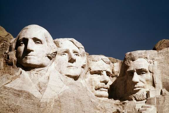 FILE - In this undated photo, the statues of George Washington, Thomas Jefferson, Teddy Roosevelt and Abraham Lincoln are shown at Mount Rushmore in South Dakota. Theodore Roosevelt and two more Roosevelts who occupied the White House, President Franklin Delano Roosevelt and his first lady, Eleanor, are the subjects of a new Ken Burns documentary for public television, �The Roosevelts: An Intimate History.� (AP Photo, File)