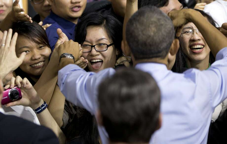 President Obama greets people in the audience after speaking to Vietnamese young people during the Young Southeast Asian Leaders Initiative town hall meeting in Ho Chi Minh City. Photo: Carolyn Kaster, Associated Press