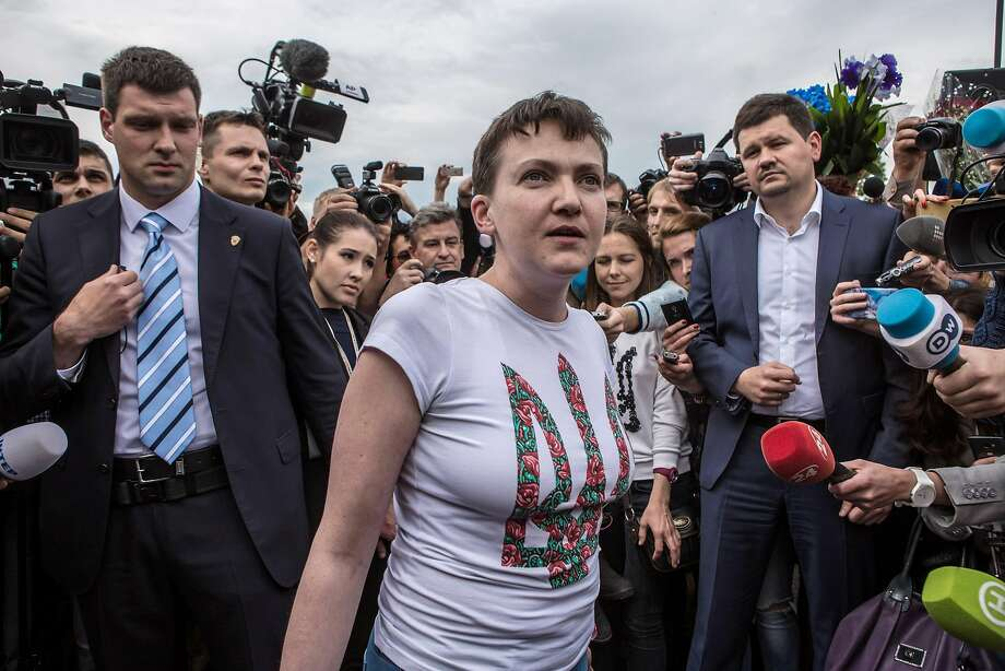 Nadiya Savchenko is surrounded by media upon her return home. She was reportedly swapped for two Russian fighters. Photo: Brendan Hoffman, Getty Images
