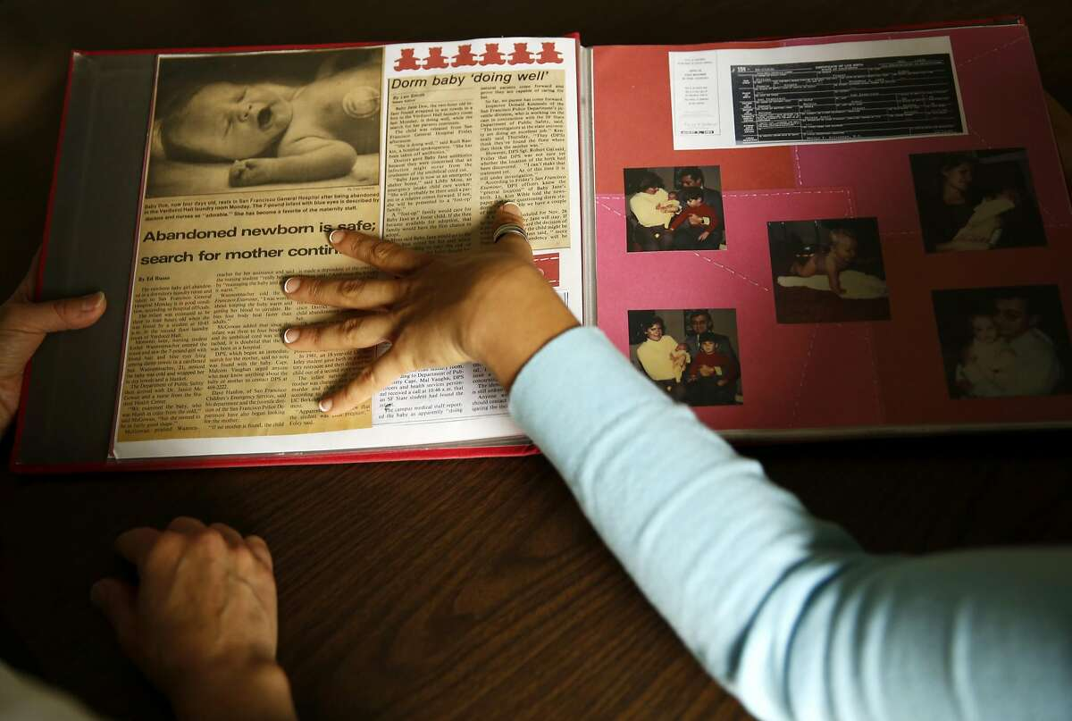 Esther Raiger (left) and Jillian Sobol look through Sobol's scrapbook detailing her adoption story after she was helped by Raiger in a dormitory at S.F. State.