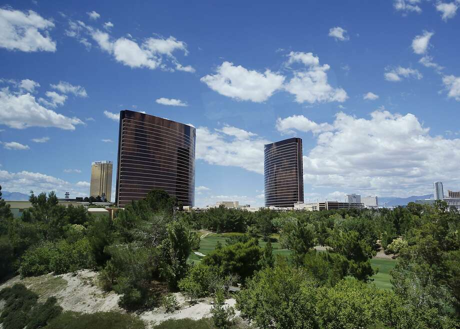 Wynn and Encore hotel towers rise above the Wynn golf course in Las Vegas. The 38-acre man-made lake would be built on the site of the 18-hole course. Photo: John Locher, Associated Press