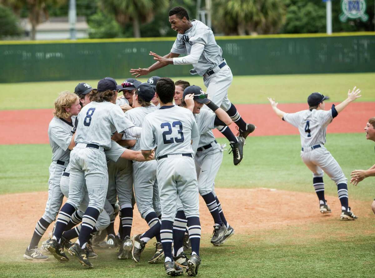 Second Baptist celebrates it's 7-2 win over Midland Christian to capture the TAPPS Class 4A state baseball championship at Baseball USA on Wednesday, May 25, 2016, in Houston.