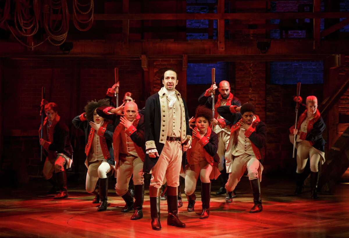 In this image released by The Public Theater, Lin-Manuel Miranda, center, performs in the musical