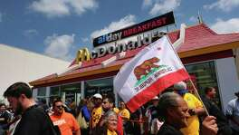 In 2012, a group called Fight for $15 began pressuring fast-food chains, especially McDonald's, to raise their wages and allow restaurants employees to unionize. Since then, protests such as this April one in Los Angeles have been held across the U.S. and even internationally.