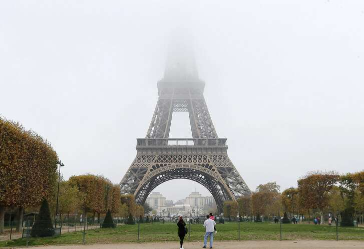 Fog and smog swallow up the top of the Eiffel Tower in Paris. Monday, Nov.2, 2015. Paris authorities have put in place measures to limit traffic after high levels of pollution in the French capital. France is proposing the automatic updating of countries' emissions targets in a climate deal to be thrashed out at a U.N. conference in Paris beginning later this month. (AP Photo/Jacques Brinon)