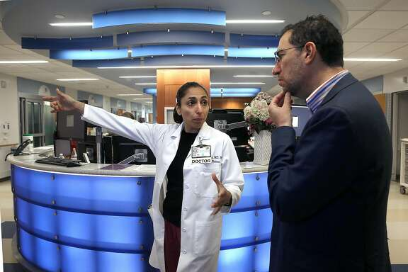 Malini Singh, MD, (left) gives the Centers for Medicare and Medicaid acting administrator Andy Slavitt (right) a tour of the new emergency room at San Francisco General Hospital on Tuesday, May 24, 2016 in San Francisco, Calif.