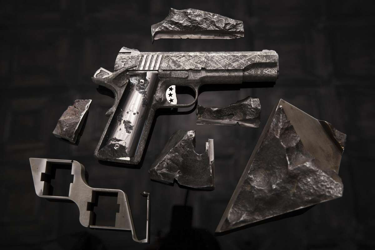 """Cabot Guns, a Pennsylvania-based gun manufacturer, released a set of images showcasing its latest luxury handgun set, """"The Big Bang."""" The M1911 pistols you see here have been hewn from meteorite ore, specifically the Gibeon meteorite that landed in southeastern Africa. The set is priced at around $4.5 million. Source: Cabot Guns"""