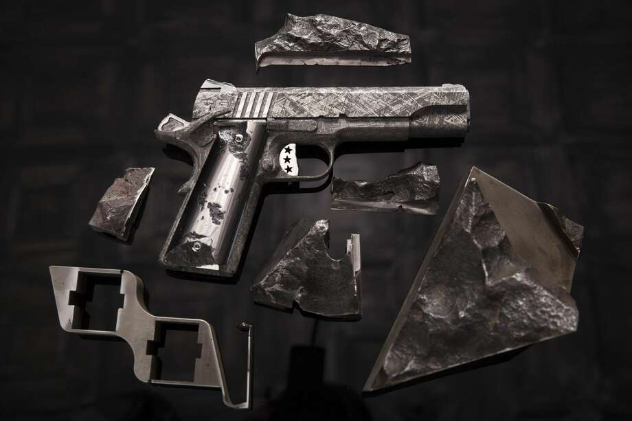 "Cabot Guns, a Pennsylvania-based gun manufacturer, released a set of images showcasing its latest luxury handgun set, ""The Big Bang."" The M1911 pistols you see here have been hewn from meteorite ore, specifically the Gibeon meteorite that landed in southeastern Africa. The set is priced at around $4.5 million.Source: Cabot Guns Photo: File/Cabot Guns/Courtesy To The Houston Chronicle"