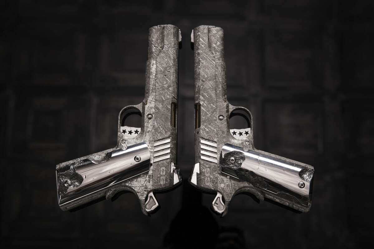 """Cabot Guns, a Pennsylvania-based gun manufacturer, released a set of images showcasing its latest luxury handgun set, """"The Big Bang."""" The M1911 pistols you see here have been hewn from meteorite ore, specifically the Gibeon meteorite that landed in southeastern Africa. The set is priced at around $4.5 million. Source:Cabot Guns"""