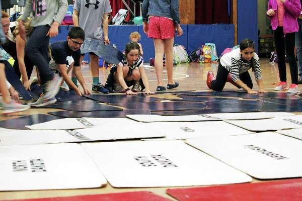Stratfield School students practice assembling their marching map of the U.S. in preparation for Monday's Memorial Day parade.