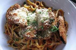 Eggplant Parmesan is part of the menu at Green Vegetarian Cuisine.