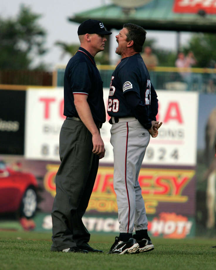 Asheville Tourists manager Joe Mikulik, right, argues a call with an umpire in the fifth inning against the Lexington Legends in a single A minor league baseball game on Sunday, June 25, 2006, in Lexington, Ky. Mikulik, who was ejected, later picked up and threw  second base into the outfield, then threw the rosin bag on his way back to the dugout. Mikulik also threw bats from the dugout onto the field, covered home plate with dirt, then poured water on it as he continued to argue with home plate umpire. Photo: BRIAN TIETZ, AP / LEXINGTON HERALD-LEADER