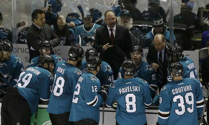 San Jose Sharks head coach Peter DeBoer talks to his team during the third period of an NHL hockey game against the St. Louis Blues Tuesday, March 22, 2016, in San Jose, Calif. (AP Photo/Marcio Jose Sanchez)