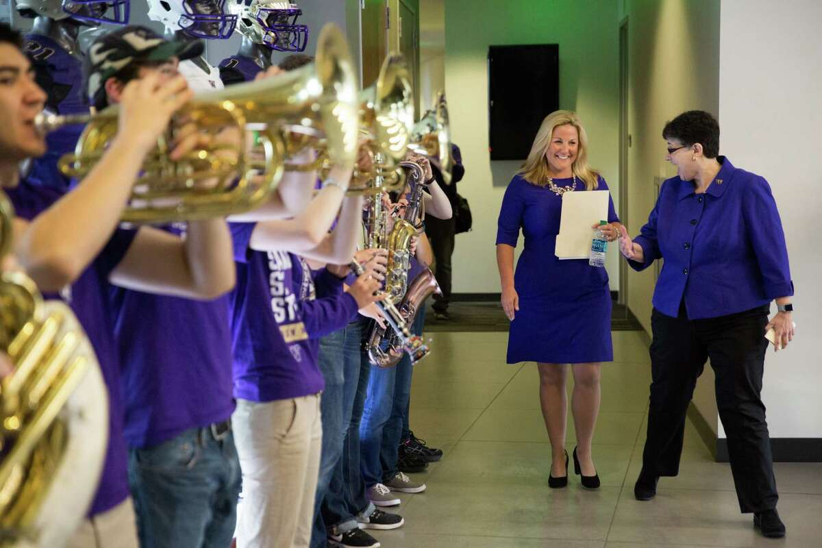 University of Washington president Ana Mari Cauce welcomes new athletic director Jennifer Cohen through the band at her introductory presser at Husky Stadium, Wednesday, May 25,, 2016.