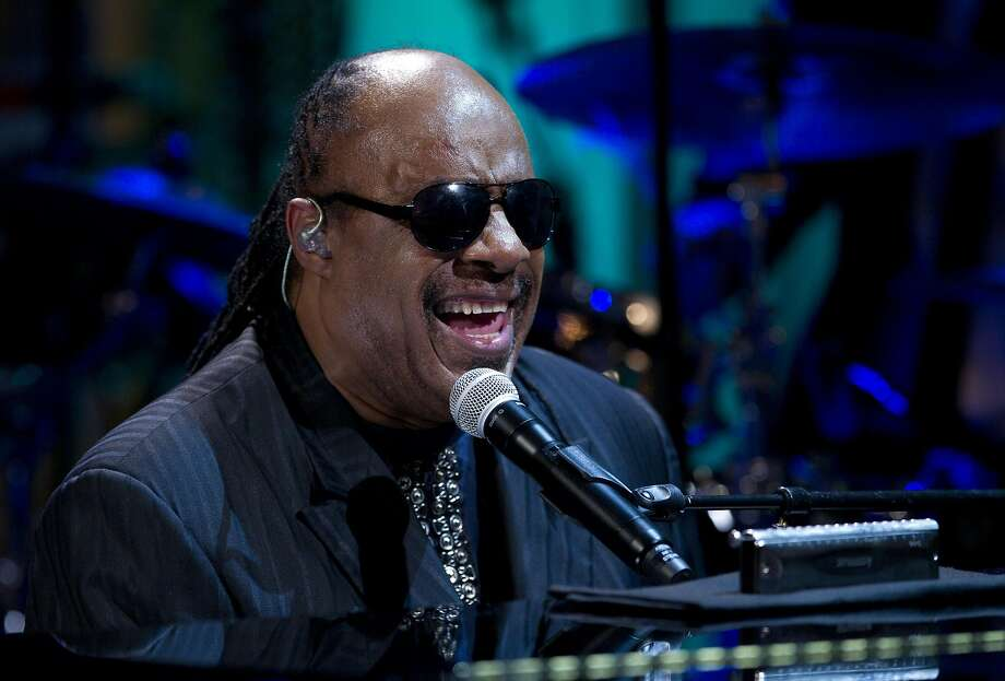 """FILE - In this May 9, 2012 file photo, Stevie Wonder performs during the """"In Performance at the White House"""" in the East Room of the White House in Washington. A piano used by Stevie Wonder when he was a student in Michigan has been loaned to the Museum of the American Printing House for the Blind in Louisville, Ky., and will be on display starting next week. The 1922 Steinway grand piano was long used by students at the Michigan School for the Blind, where Wonder, a child prodigy, studied in the mid-1960s. Wonder signed with Motown at the age of 11 and went on to become a singer, songwriter and multi-instrumentalist. It goes on display starting Oct. 11. (AP Photo/Carolyn Kaster, File) Photo: Carolyn Kaster, ASSOCIATED PRESS"""