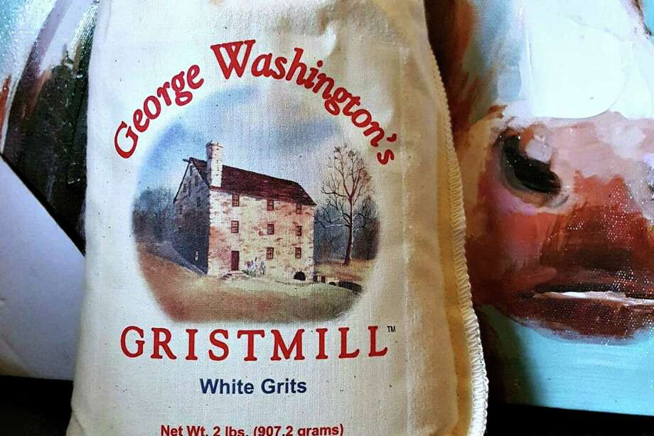 Products made and sold at George Washington's Gristmill at Mount Vernon include white and yellow grits and cornmeal, and pancake mix.  Photo: Gretchen McKay, MBR / Pittsburgh Post-Gazette