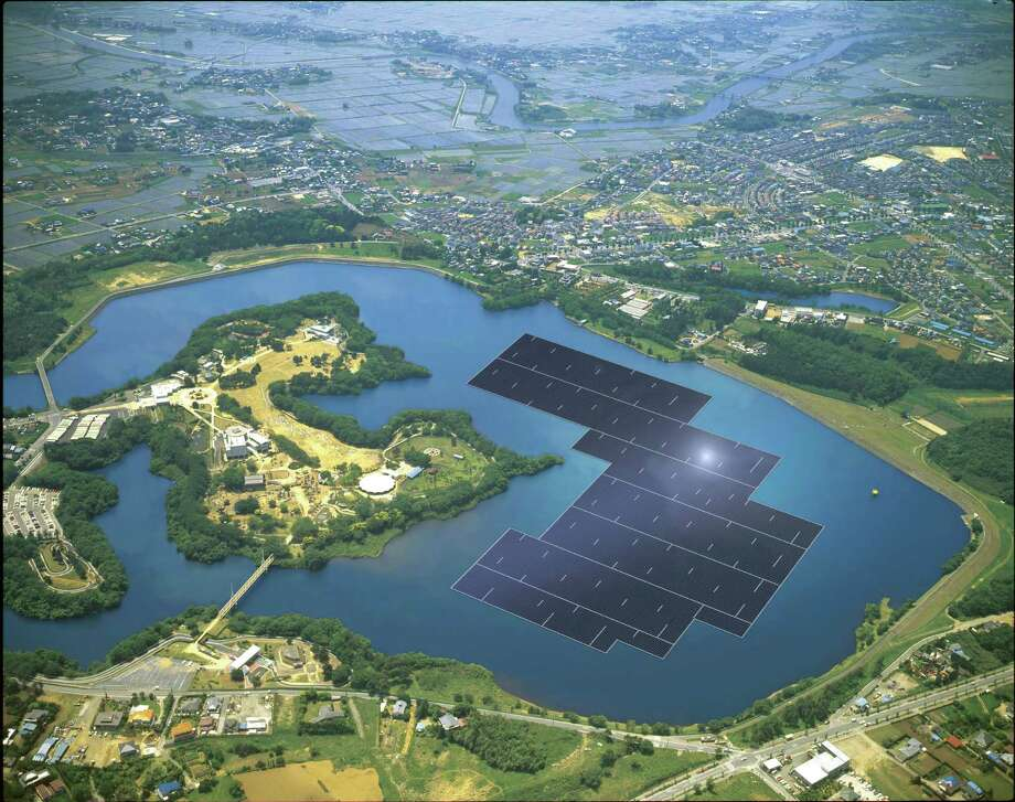 A rendering from Kyocera shows blue solar panels stretching across part of the Yamakura Dam reservoir in Japan's Chiba Prefecture. In two years, if construction goes as planned, 50,904 panels will float atop the reservoir, generating an estimated 16,170 megawatt hours annually, enough electricity to power almost 5,000 homes, according to Kyocera, the company building the solar plant. Photo: Kyocera /New York Times / KYOCERA